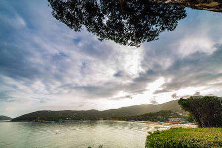 exciting panorama of clear and blue sea and beautiful beach of Island of Elba under the sun of Tuscany in Italy