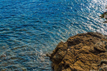 rocks on clear and blue sea of Island of Elba under the sun of Tuscany in Italy