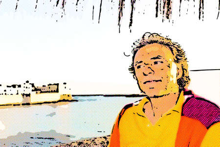 Handsome tanned middle-aged man with salt pepper hair in casual clothing with red and orange sweater and yellow polo shirt in Italian outdoors: he is relaxed under umbrella palm while antique buildings are facing on seaside on the background