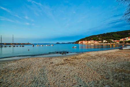 elba: panoramic view moored boats in bay of Tyrrhenian Sea from Elba Island in Italy