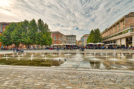 water games of XIX century fountain in front of weekly market in large square in Reggio Emilia Stock Photo