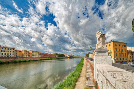 feelings of history in the ancient buildings along the river in Pisa under the sun of Tuscany, Italy