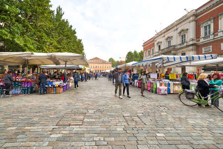 weekly market in large square in Reggio Emilia