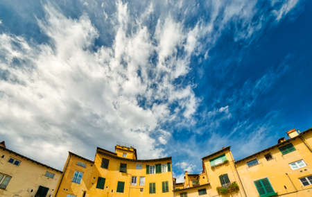 ancient buildings on the main square of Lucca, rare preserved wonder of medieval architecture in Italy Stock Photo