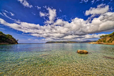 clear and blue sea of Island of Elba under the sun of Tuscany in Italy Stock Photo