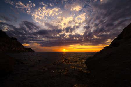 Scenic coastal sunset with orange light on island of Elba Stock Photo