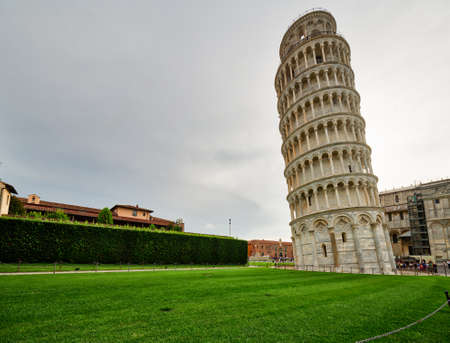 view of public Square of miracles in Pisa with the leaning tower, one of the most famous landmarks of Italy Stock Photo