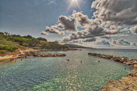 panorama of clear and blue sea of Island of Elba under the sun of Tuscany in Italy