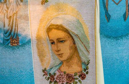MEDJUGORJE, BOSNIA AND HERZEGOVINA - NOVEMBER 5:  the Blessed Virgin Mary embroidered on fabric in Medjugorje, a popular destination for pilgrims on November 5, 2017. Editorial