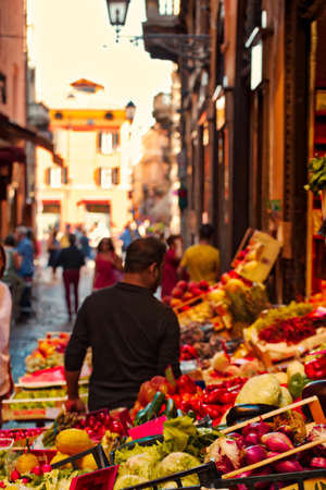 BOLOGNA, ITALY - AUGUST 27:  tourists and locals visiting the stalls in the medieval market on August 27, 2016. The trade vocation of this area known as Quadrilatero, meaning The Quadrangle was born in Middle Ages