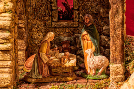 Christmas creche with Baby Jesus, Saint Joseph and Blessed Virgin Mary and the ox and the donkey