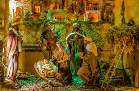 Christmas Nativity scene of baby Jesus in the manger with Saint Joseph, the Blessed Virgin Mary, the ox, the donkey and the three Wise men Stock Photo