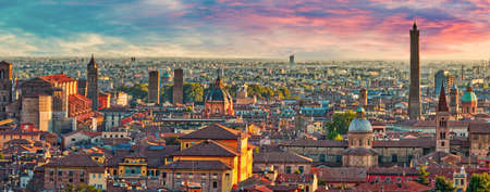 ancient buildings and medieval towers in aerial panoramic cityscape of Bologna, Italy under dramatic sky Stock Photo