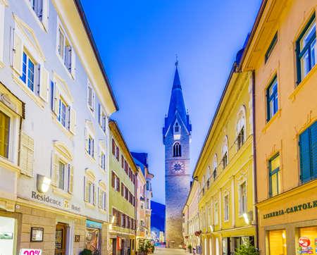 BRESSANONE, BOLZANO, ITALY - JANUARY 28: tourists walking in center of Bressanone at night on January 2016. the area of Bolzano is a popular destination in winter