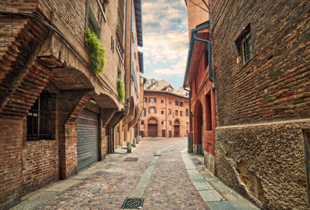 ancient buildings in street in the old city of Bologna, Italy Stock Photo