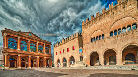 Ancient buildings in square of Rimini in Italy in a cloudy day Stock Photo