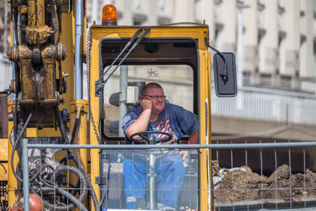 BUDAPEST, HUNGARY - SEPTEMBER 17, 2014: worker rests in the cabin of the crane. Thanks to investments in public works too, every year the number of tourists visiting Budapest increases. Editorial