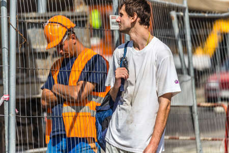 BUDAPEST, HUNGARY - SEPTEMBER 17, 2014: worker rests behind wire mesh. Thanks to investments in public works too, every year the number of tourists visiting Budapest increases.