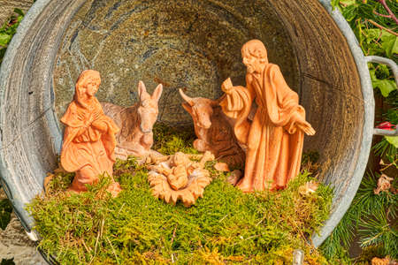 Christmas Nativity scene with The Holy Child, The Blessed Virgin Mary, Saint Joseph, ox and donkey