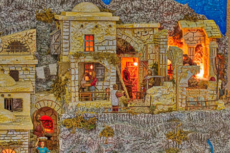 Details of Arts and Crafts in houses of village with lights  in Christmas Nativity scene