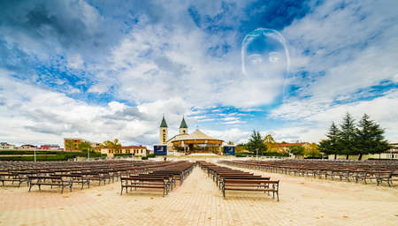 Icon of the Blessed Virgin Mary blended in the sky over Catholics Church of Saint James in Medjugorje Stock Photo