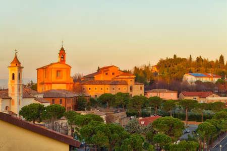 winter sunset on the roofs of  Italian medieval village Stock Photo