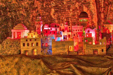 colorful lights on reproduction of Middle Easter village of Ancient Palestine in Nativity scene Imagens