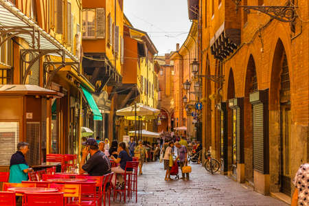 BOLOGNA, ITALY - AUGUST 27, 2016:  tourists and locals go shopping in the medieval market. The trade vocation of this area known as Quadrilatero, meaning The Quadrilateral Area, was born in Middle Ages
