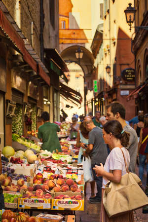BOLOGNA, ITALY - AUGUST 27, 2016:  tourists and locals go shopping in medieval market. The trade vocation of this area known as Quadrilatero, meaning The Quadrilateral Area, was born in Middle Ages Sajtókép