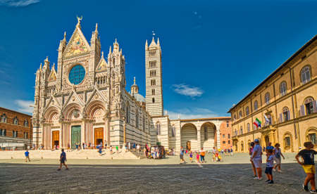 SIENA, ITALY - AUGUST 28, 2017: tourists visit the Cathedral of Siena during summer holidays