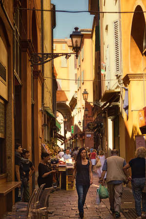 BOLOGNA, ITALY - AUGUST 27, 2016:  tourists and locals go shopping in medieval market. The trade vocation of this area known as Quadrilatero, meaning The Quadrilateral Area, was born in Middle Ages 報道画像