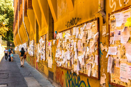 BOLOGNA, ITALY - AUGUST 27, 2016: College students still use physical bulletin boards to publish their ads