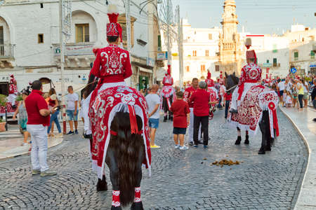 OSTUNI (BR) - AUGUST 28, 2016: Tourists and locals attend and enjoy the feast of the patron saint of the city