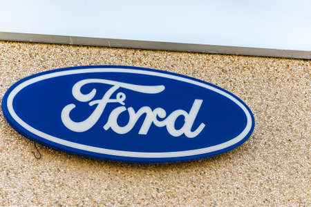 LUGO (RA) - FEBRUARY 11, 2018: Ford logo on building of dealership. Ford Motor Company is the fifth-largest automaker in the world Editorial