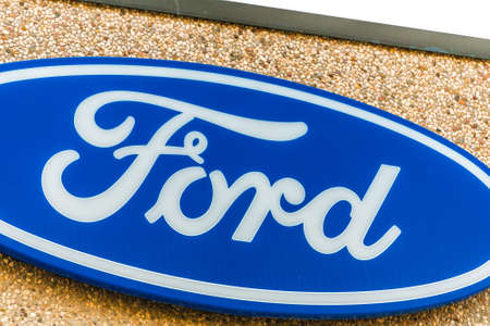 LUGO (RA) - FEBRUARY 11, 2018: Ford logo on building of dealership. Ford Motor Company is the fifth-largest automaker in the world 에디토리얼