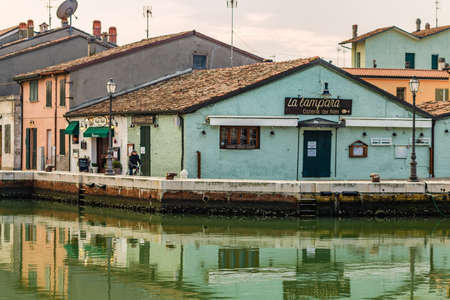 CESENATICO (FC) - FEBRUARY 10, 2018: tourists visit the port canal designed by Leonardo da Vinci in 1502 in Cesenatico, Italy