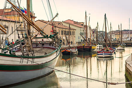 Historical boats moored in the canal port of Cesenatico