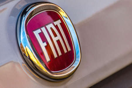 LUGO (RA) - FEBRUARY 14, 2018:  dirt covers the Fiat logo of a beige car. FCA owner of the Fiat brand is the eighth largest auto maker in the world