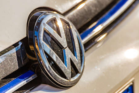 RAVENNA, ITALY - FEBRUARY 14, 2018:  dirt covers the Volkswagen logo. Two years after the emissions scandal, Volkswagen is more profitable than before and outperformed German rivals