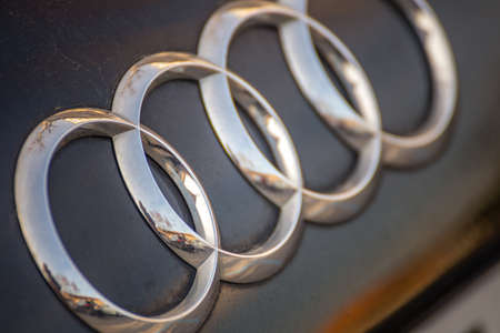 RAVENNA, ITALY - FEBRUARY 14, 2018:  dirt covers the AUDI logo. Audi recalled 127,000 luxury diesel cars after claims they were fitted with emission-cheating devices