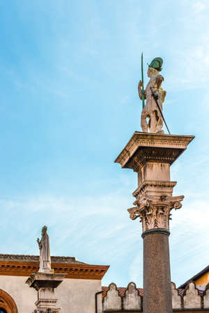 RAVENNA, ITALY - FEBRUARY 15, 2018: the statues of Saint Vitale and Saint Apollinaris  rise in Piazza del Popolo