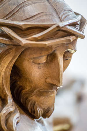 closeup of wooden statue of Jesus Christ with crown of thorns