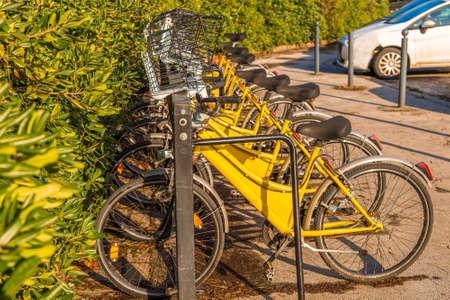 Yellow pool sharing bicycles on the bike rack