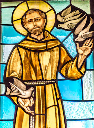 LUGO (RA) - FEBRUARY, 21 2018: Saint Francis welcoming birds in a stained glass in country church