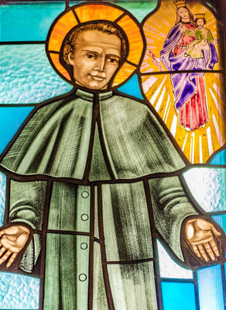LUGO (RA) - FEBRUARY, 21 2018: Saint John Bosco widening his arms in a stained glass in country church Editorial
