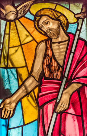 LUGO (RA) - FEBRUARY, 21 2018:  Saint John the Baptiste walking and preaching the Word of God in a stained glass in country church Editorial