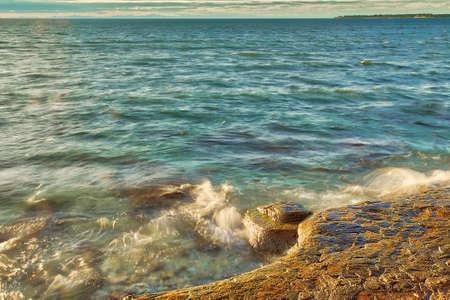 sea waves crashing against rocks in Croatian bay