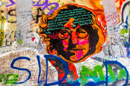PRAGUE, CZECH - AUGUST 28, 2014: the Lennon wall is a symbol for young people who keeps on drawing graffiti inspired by John Lennon and Beatles lyrics Editorial
