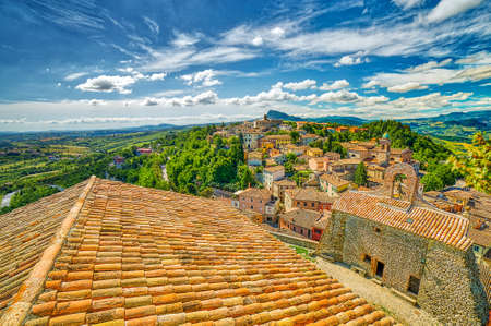 view of Italian medieval village on hilly countryside Stock Photo