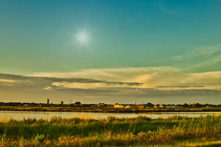 deep sunset on brackish wetlands 스톡 콘텐츠 - 104452223